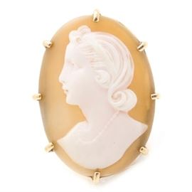 14K Yellow Gold Helmet Shell Cameo Ring: A 14K yellow gold ring featuring a helmet shell cameo displaying the profile of a woman resting between split shoulders.