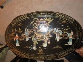 Black lacquered oval table, 6 stools, Glass top, inlaid figures