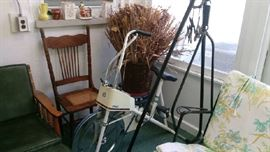 Exercise bike, antique cane seat chair