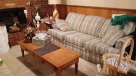 plaid sofa, oak coffee table, lamps