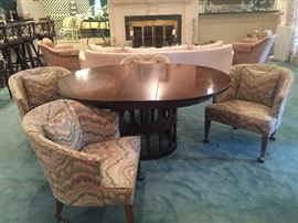 Mid-Century Modern table with one leaf - Round or oval options.  Flame stitch Mid-Century chairs on rolling brass casters