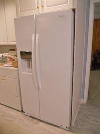 Side-by-side Whirlpool refrigerator freezer