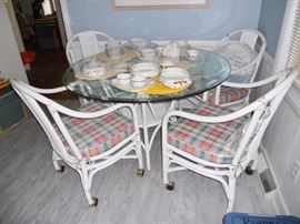 Round rattan glass top kitchen table with 4 matching chairs with casters