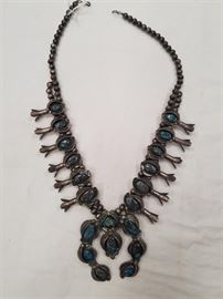 One of many squash blossom sterling and turquoise necklaces