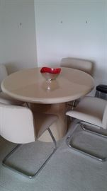 Mid century modern dinette with pristine pebble leather chairs