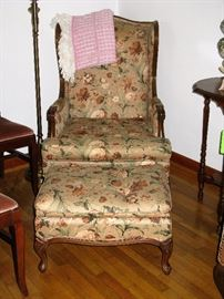 One of two chairs with matching ottoman