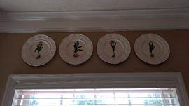 Set of 4 decorative matching plates.