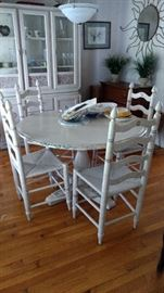 This table and chairs set is certainly one of a kind!!  It's been hand painted with lots of detail.