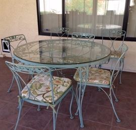 Vintage Green Wrought Iron Table w/ 4 chairs. 2 extra chairs priced separately.