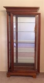Display Curio Cabinet with sliding glass door.