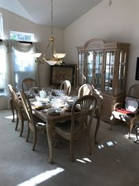 Universal Light Wood Dining Room Set - Table With 8 Chairs And 2 Leaves - Matching Lighted China Cabinet