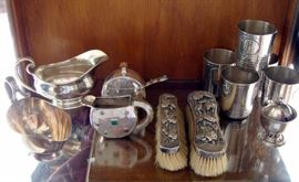 Emilia Castillo tumblers, sugar and creamer, sterling clothes brushes, Georg Jensen mustard jar, sterling sauce boats