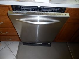 Kitchen Aid top of the line silent running three draw dishwasher.