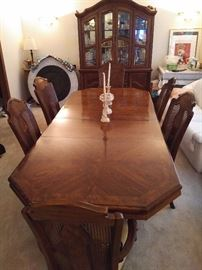 Magnificent Hardwood Dining Set.  Table has two leaves.  Includes breakfront, 4 standard chairs and two arm chairs.