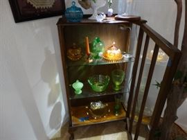 a snakk dusplay cabinet w/ depression glass