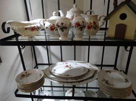 a small baker's rack w/ insert glass shelves and a large set of Moss Rose Dinnerware