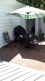 Patio iron table and 4 chairs