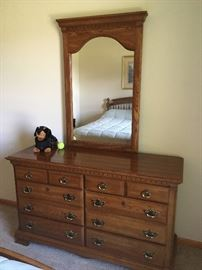 This is a beautiful oak dresser -- part of the two wonderful bedroom sets.
