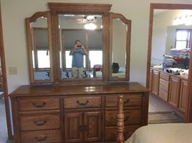 This is a part of an original Queen bedroom set that retailed for over $10,000.00.  Google American Drew furniture -- excellent quality productions for many years.  This dresser is part of a 4-piece set that includes the Queen bed (post in foreground) and two night stands.