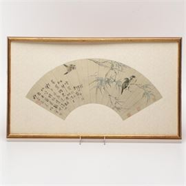"East Asian Style Framed Fan With Images of Birds: An East Asian style framed fan. Printed on paper, the fan features images of birds perched on bamboo branches on one side. The fan is mounted to an ivory color brocade fabric and is displayed in a gold tone wooden frame with a hanging wire to the verso. A label reading ""The Ainsworth Gallery"" is also attached to the verso."