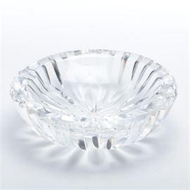 """Giftware by Waterford"" Crystal Ashtray: A Giftware by Waterford crystal ashtray. The bowl features two cigarette rests, vertical cuts, with a star to the underside. The piece is etched on the underside."