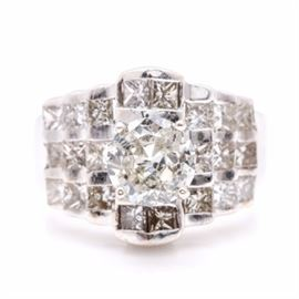 14K White Gold 2.24 CTW Diamond Ring: A 14K white gold 2.24 ctw diamond ring. This ring features a central, peg head set diamond surrounded by stepped clusters of diamonds leading to tapered shoulders.