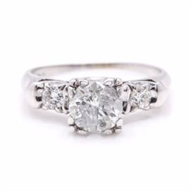 14K White Gold 1.31 CTW Diamond Ring: A 14K white gold 1.31 ctw diamond ring. This ring has a decorative setting with openwork gallery and is flanked by smaller diamonds with high polished tapered shoulders.