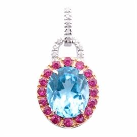 14K Two Tone Gold 5.86 CT Blue Topaz, Ruby, and Diamond Pendant: A 14K two tone gold pendant containing a central prong set 5.86 ct blue topaz stone highlighted by sixteen surrounding rubies flush set in yellow gold. Eleven diamond accents adorn an open semi-circle detail and concealed pendant bail.