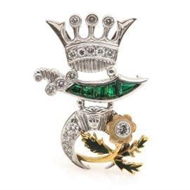 Platinum and 10K Yellow Gold Shriner's Brooch With Diamonds and Beryl Triplets: A platinum and 10K yellow gold Shriner's brooch. This features a platinum design with 10K yellow gold accents and includes the crown, crescent, fez and scimitar motifs representing the characteristics of the Shriner's fraternity. The brooch is adorned with diamonds, enamel and beryl triplets.