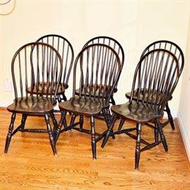 David T. Smith Windsor-Style Side Chairs: A set of six Windsor-style chairs from the Workshops of David T. Smith. These beautifully crafted chairs feature round splats supported with mortise and tenon joinery to rounded backs, with shaped seats, and turned legs. They feature a distressed black finish with hints of the patinated wood exposed in worn areas. All six chairs feature the maker's mark to the underside of the seat.