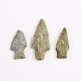 Arrowheads: A collection of three arrowheads. This set of arrowheads are knapped from stone and have pointed edges that resemble blades.