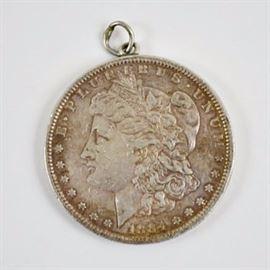 1884 Silver Morgan Dollar: An 1884 silver morgan dollar pendant.