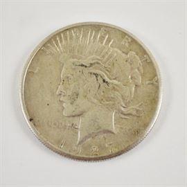 1927 Silver Peace Dollar: A 1927 silver peace dollar. Designer: Anthony de Francisci.