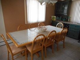 Sturdy dining set for 8, table has one leaf