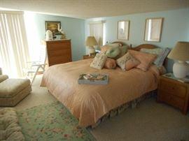 Handsome wicker bedroom ensemble with king headboard