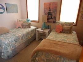 Multiple twin/single beds; nesting wicker tables