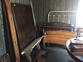 Old beds with head & foot boards.  Wall shelves