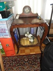 Mahogany splay leg table, Ansonia clock, brass try and candlestick