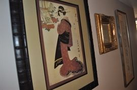 Variety of framed art and mirrors
