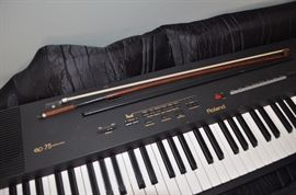 Roland EP 75 digital piano keyboard in case, excellent condition, violin bow