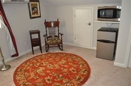 Floor lamp (barely visible), two-tiered table, spindle back rocker with upholstered seat, one of several area rugs available, Frigidaire double door 3.1cf refrigerator NEW, GE Profile Sensor Convection 1.5cf microwave (SOME SOLD)