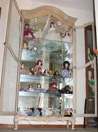 curio filled with MORE dolls