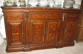 Beautiful dining room buffet with marble top