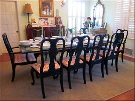 Glamorous Glass Dining Table with Ten Lacquered Dining Chairs.