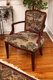 Armchair with hunt scene upholstery.