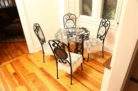Iron and glass table with four chairs.