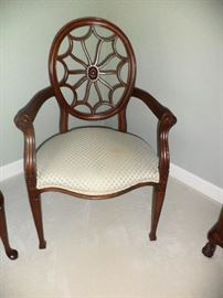 Spider web motif chair-maker unknown;purchased new in Indiana  25 yrs ago