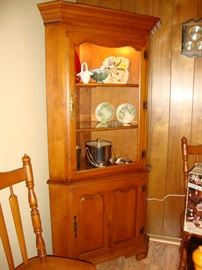 One of two matching corner cabinets