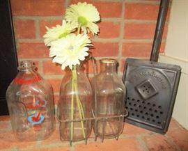 Vintage milk bottles, bottle carrier