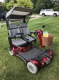 SHOPRIDER MOTORIZED FOUR WHEEL PERSONAL TRAVEL SCOOTER - DOUBLE SEATER- MSRP $5,200